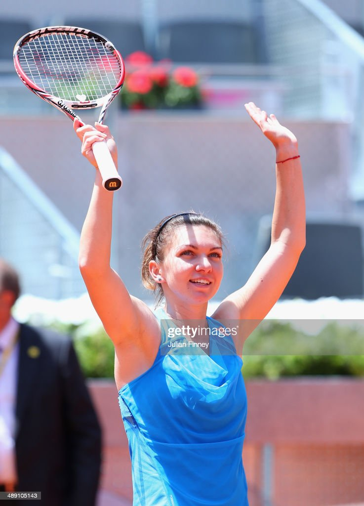Simona Halep of Romania celebrates defeating Petra Kvitova of Czech Republic during day eight of the Mutua Madrid Open tennis tournament at the Caja Magica on May 10, 2014 in Madrid, Spain.