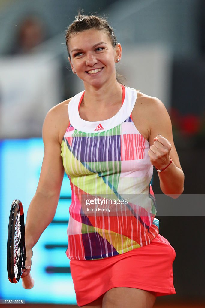 Simona Halep of Romania celebrates defeating Sam Stosur of Australia in the semi finals during day seven of the Mutua Madrid Open tennis tournament at the Caja Magica on May 06, 2016 in Madrid, Spain.