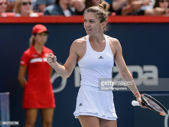 Simona Halep of Romania celebrates her victory over Angelique Kerber of Germany during day six in semifinal round action of the Rogers Cup at Uniprix...