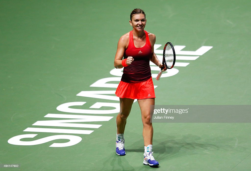 <a gi-track='captionPersonalityLinkClicked' href=/galleries/search?phrase=Simona+Halep&family=editorial&specificpeople=4835837 ng-click='$event.stopPropagation()'>Simona Halep</a> of Romania celebrates match point against Flavia Pennetta of Italy in a round robin match during the BNP Paribas WTA Finals at Singapore Sports Hub on October 25, 2015 in Singapore.