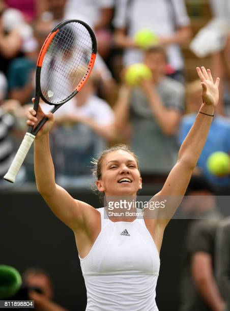 Simona Halep of Romania celebrates victory after the Ladies Singles fourth round match against Victoria Azarenka of Belarus on day seven of the...