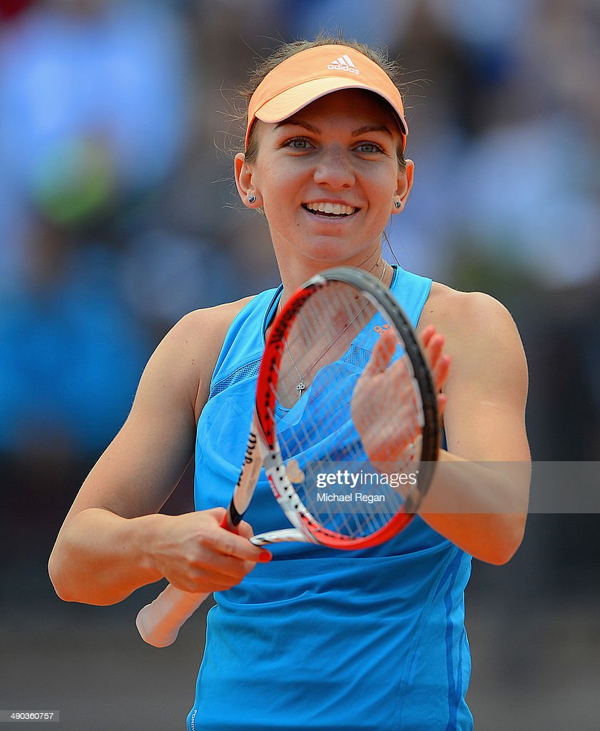 <a gi-track='captionPersonalityLinkClicked' href=/galleries/search?phrase=Simona+Halep&family=editorial&specificpeople=4835837 ng-click='$event.stopPropagation()'>Simona Halep</a> of Romania celebrates victory against Madison Keys of the USA during day 4 of the Internazionali BNL d'Italia 2014 on May 14, 2014 in Rome, Italy.