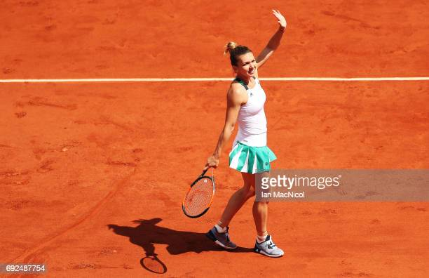 Simona Halep of Romania celebrates victory during her match with Carla Suarez Navarro of Spain on Day Nine at Roland Garros on June 5 2017 in Paris...