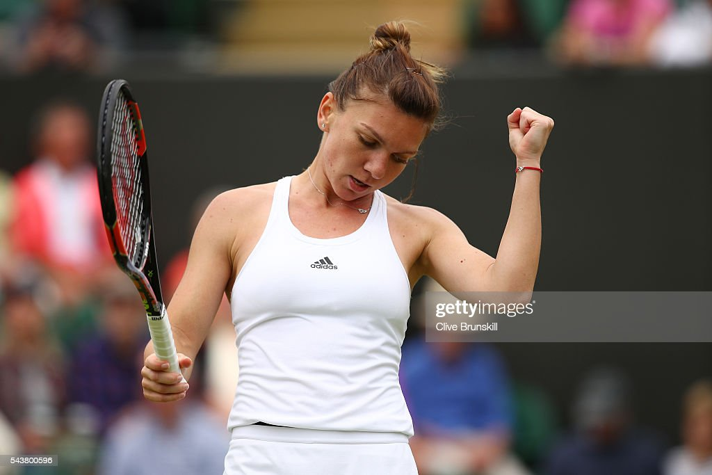 <a gi-track='captionPersonalityLinkClicked' href=/galleries/search?phrase=Simona+Halep&family=editorial&specificpeople=4835837 ng-click='$event.stopPropagation()'>Simona Halep</a> of Romania celebrates victory during the Ladies Singles second round match against Francesca Schiavone of Italy on day four of the Wimbledon Lawn Tennis Championships at the All England Lawn Tennis and Croquet Club on June 30, 2016 in London, England.