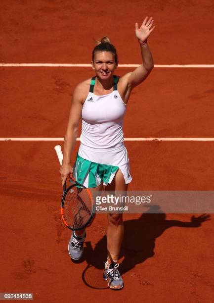 Simona Halep of Romania celebrates victory during the ladies singles fourth round match against Carla Suarez Navarro of Spain on day nine of the 2017...