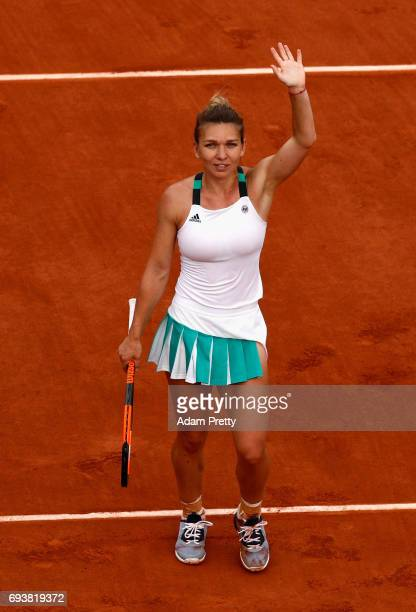 Simona Halep of Romania celebrates victory following the ladies singles semifinal match against Karolina Pliskova of The Czech Republic on day twelve...
