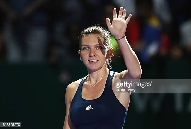 Simona Halep of Romania celebrates victory in her singles match against Madison Keys of the United States during day 1 of the BNP Paribas WTA Finals...