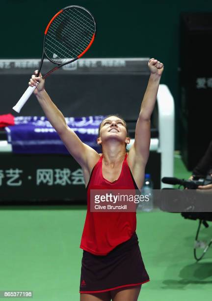Simona Halep of Romania celebrates victory in her singles match against Caroline Garcia of France during day 2 of the BNP Paribas WTA Finals...