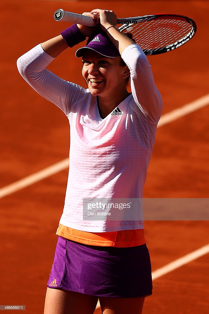 Simona Halep of Romania celebrates victory in her women's singles quarter-final match against Svetlana Kuznetsova of Russia on day eleven of the French Open at Roland Garros on June 4, 2014 in Paris, France.