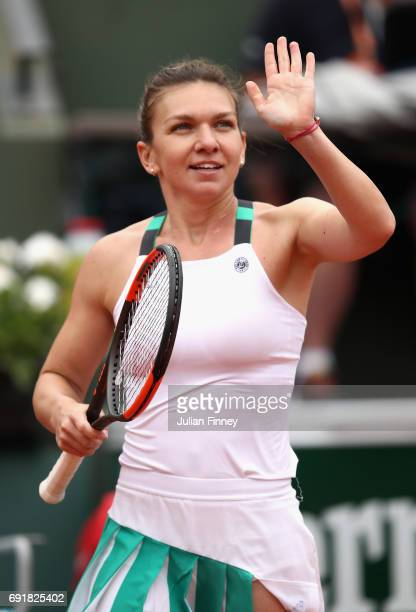 Simona Halep of Romania celebrates victory in the ladies singles third round match against Daria Kasatkina of Russia on day seven of the 2017 French...