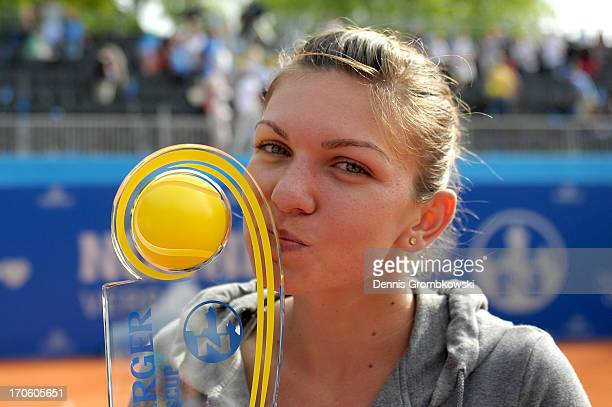 Simona Halep of Romania celebrates with the trophy after winning the Nuernberger Insurance Cup final against Andrea Petkovic of Germany during day...