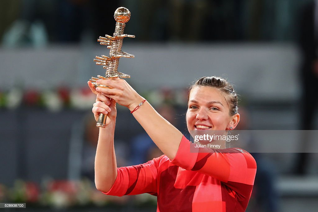 <a gi-track='captionPersonalityLinkClicked' href=/galleries/search?phrase=Simona+Halep&family=editorial&specificpeople=4835837 ng-click='$event.stopPropagation()'>Simona Halep</a> of Romania celebrates with the winners trophy after her win over Dominika Cibulkova of Slovakia in the final during day eight of the Mutua Madrid Open tennis tournament at the Caja Magica on May 07, 2016 in Madrid, Spain.
