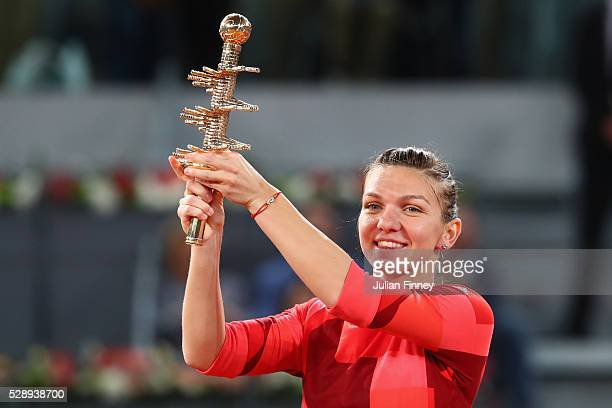 Simona Halep of Romania celebrates with the winners trophy after her win over Dominika Cibulkova of Slovakia in the final during day eight of the...