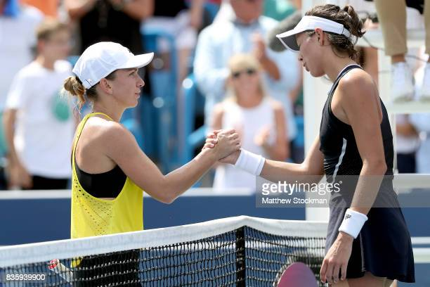 Simona Halep of Romania congratulates Garbine Muguruza of Spain after their match during the women's final on day 9 of the Western Southern Open at...