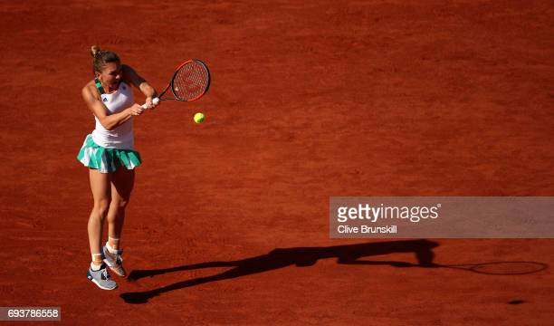 Simona Halep of Romania hits a backhand during the ladies semi final match against Kistyna Pliskova of the Czech Republic on day twelve of the 2017...