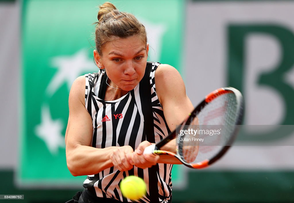 <a gi-track='captionPersonalityLinkClicked' href=/galleries/search?phrase=Simona+Halep&family=editorial&specificpeople=4835837 ng-click='$event.stopPropagation()'>Simona Halep</a> of Romania hits a backhand during the Ladies Singles second round match against Zarina Diyas of Kazakhstan at Roland Garros on May 25, 2016 in Paris, France.