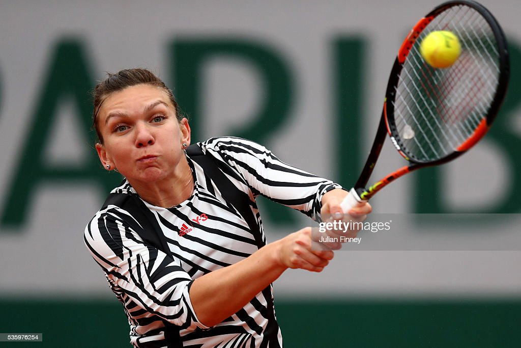 <a gi-track='captionPersonalityLinkClicked' href=/galleries/search?phrase=Simona+Halep&family=editorial&specificpeople=4835837 ng-click='$event.stopPropagation()'>Simona Halep</a> of Romania hits a backhand during the Ladies Singles fourth round match against Samantha Stosur of Australia on day ten of the 2016 French Open at Roland Garros on May 31, 2016 in Paris, France.