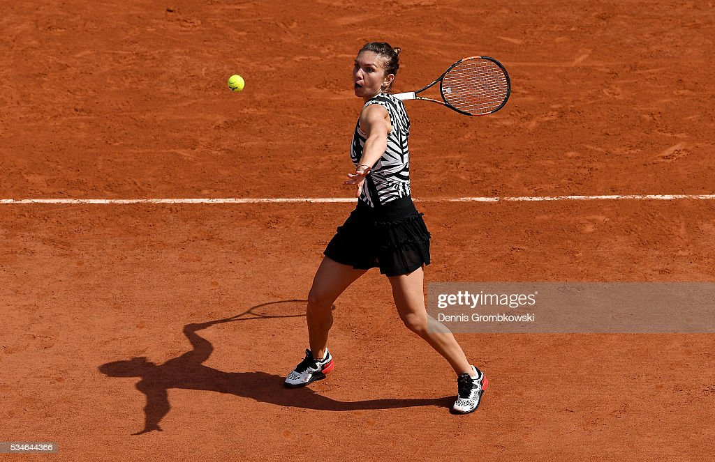 <a gi-track='captionPersonalityLinkClicked' href=/galleries/search?phrase=Simona+Halep&family=editorial&specificpeople=4835837 ng-click='$event.stopPropagation()'>Simona Halep</a> of Romania hits a forehand during the Ladies Singles third round match against Naomi Osaka of Japan on day six of the 2016 French Open at Roland Garros on May 27, 2016 in Paris, France.