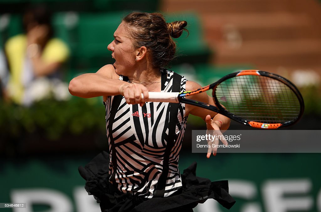 Simona Halep of Romania hits a forehand during the Ladies Singles third round match against Naomi Osaka of Japan on day six of the 2016 French Open at Roland Garros on May 27, 2016 in Paris, France.