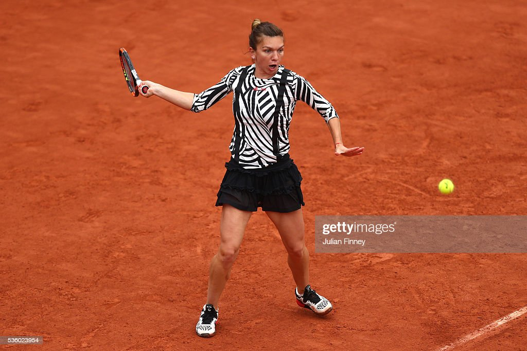 <a gi-track='captionPersonalityLinkClicked' href=/galleries/search?phrase=Simona+Halep&family=editorial&specificpeople=4835837 ng-click='$event.stopPropagation()'>Simona Halep</a> of Romania hits a forehand during the Ladies Singles fourth round match against Samantha Stosur of Australia on day ten of the 2016 French Open at Roland Garros on May 31, 2016 in Paris, France.