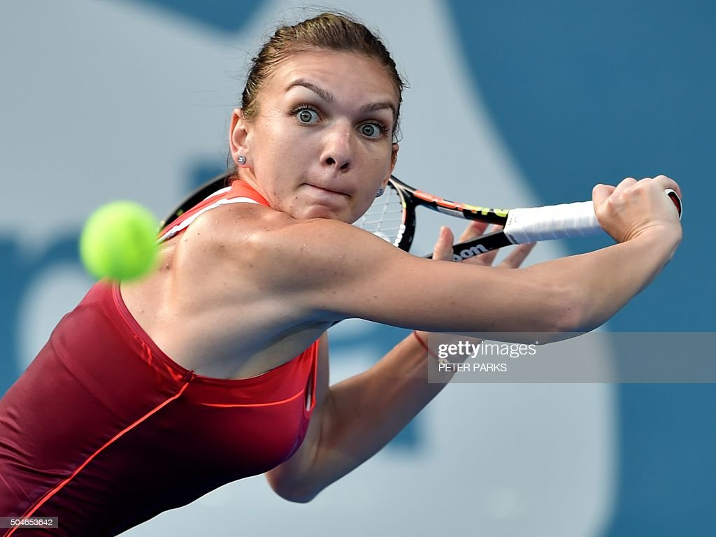 TOPSHOT - Simona Halep of Romania hits a return against Caroline Garcia of France during their women's singles second round match at the Sydney International tennis tournament in Sydney on January 12, 2016. AFP PHOTO / Peter PARKS -- IMAGE