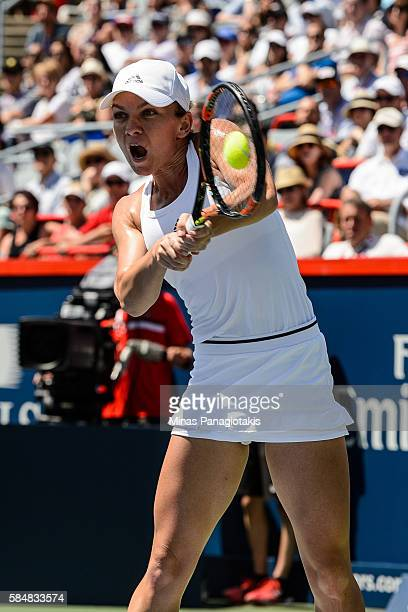 Simona Halep of Romania hits a return against Madison Keys of the United States during day seven in final round action of the Rogers Cup at Uniprix...