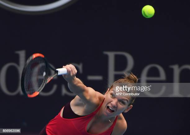 TOPSHOT Simona Halep of Romania hits a return during her women's singles match against Magdalena Rybarikova of Slovakia at the China Open tennis...
