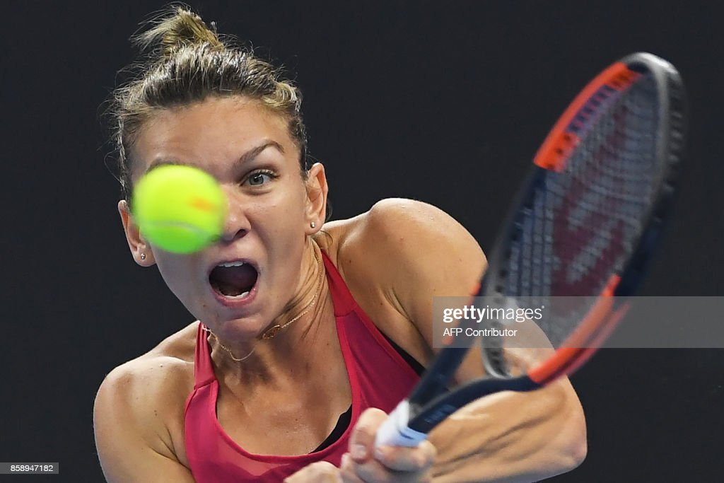 Simona Halep of Romania hits a return during the women's singles final against Caroline Garcia of France at the China Open tennis tournament in Beijing on October 8, 2017. /