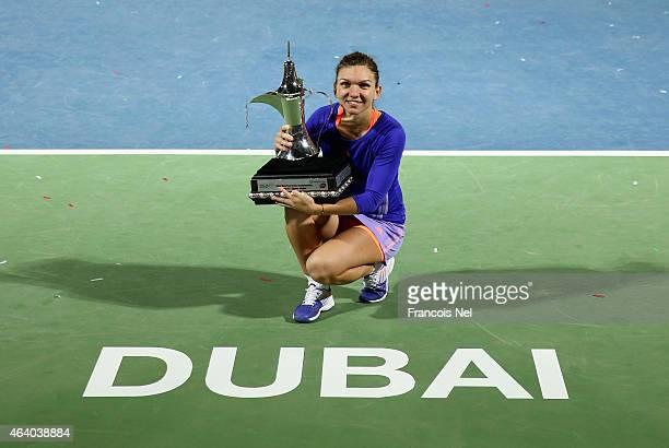 Simona Halep of Romania holds the trophy after defeating Karolina Pliskova of the Czech Republic during their women's final match of the WTA Dubai...
