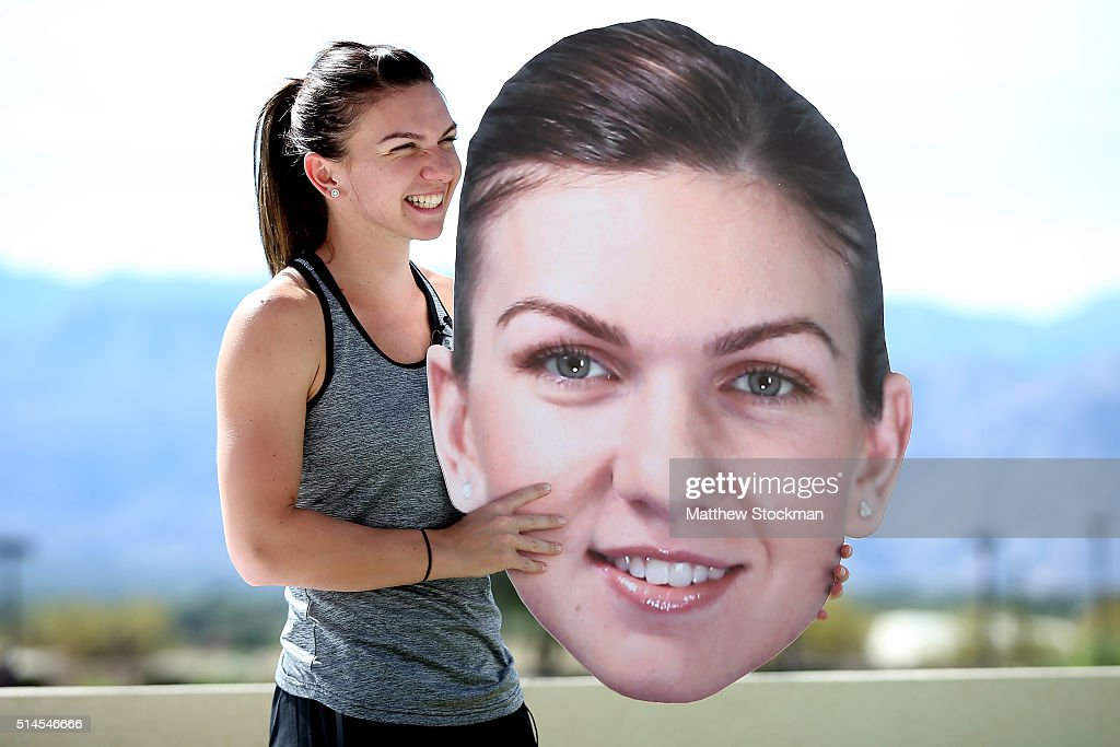Simona Halep of Romania hoplds an oversize likeness of her face at the WTA AllAccess Hour during the BNP Paribas Open at the Indian Wells Tennis...