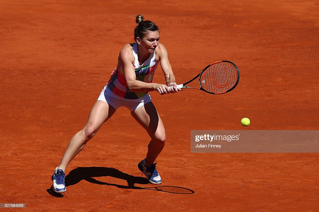 <a gi-track='captionPersonalityLinkClicked' href=/galleries/search?phrase=Simona+Halep&family=editorial&specificpeople=4835837 ng-click='$event.stopPropagation()'>Simona Halep</a> of Romania in action against Karin Knapp of Italy during day four of the Mutua Madrid Open tennis tournament at the Caja Magica on May 03, 2016 in Madrid, Spain.
