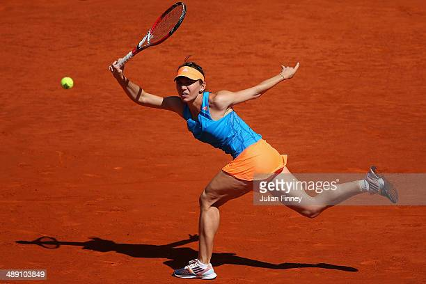 Simona Halep of Romania in action against Petra Kvitova of Czech Republic during day eight of the Mutua Madrid Open tennis tournament at the Caja...