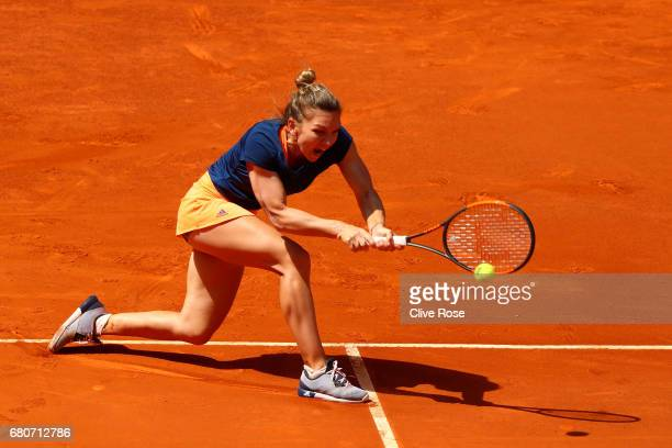 Simona Halep of Romania in action against Roberta Vinci of Italy on day four of the Mutua Madrid Open tennis at La Caja Magica on May 8 2017 in...