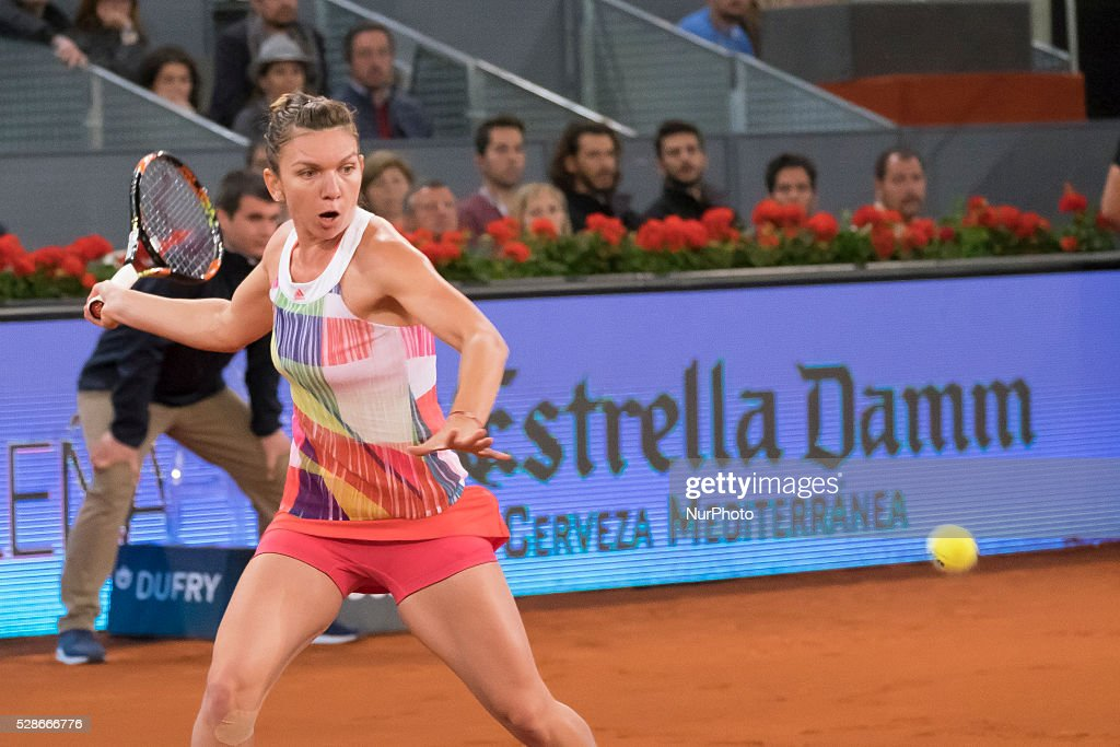 Simona Halep of Romania in action against Sam Stosur of Australia in the semi finals during day seven of the Mutua Madrid Open tennis tournament at the Caja Magica on May 06, 2016 in Madrid, Spain.
