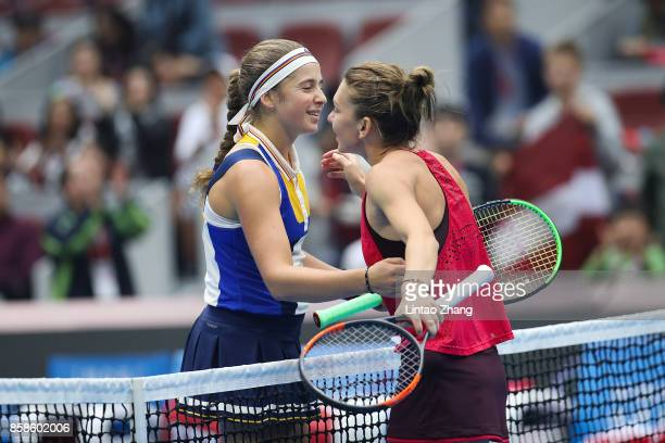 Simona Halep of Romania is congratulated by Jelena Ostapenko of Latvia after her winning the Women's Singles Semifinals match on day eight of 2017...