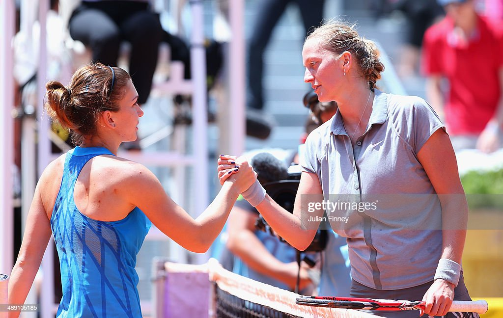 Simona Halep of Romania is congratulated by Petra Kvitova of Czech Republic after their match against during day eight of the Mutua Madrid Open tennis tournament at the Caja Magica on May 10, 2014 in Madrid, Spain.
