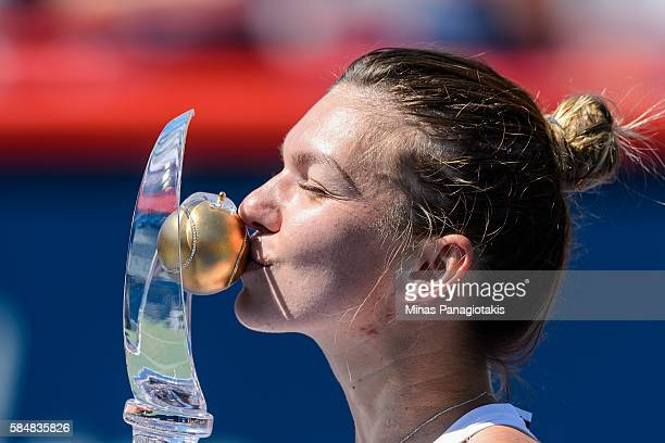 Simona Halep of Romania kisses the cup after defeating Madison Keys of the United States during day seven in final round action of the Rogers Cup at...