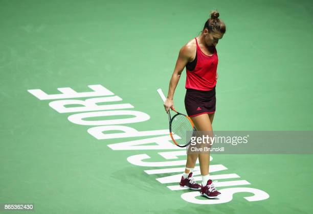Simona Halep of Romania looks dejected in her singles match against Caroline Garcia of France during day 2 of the BNP Paribas WTA Finals Singapore...
