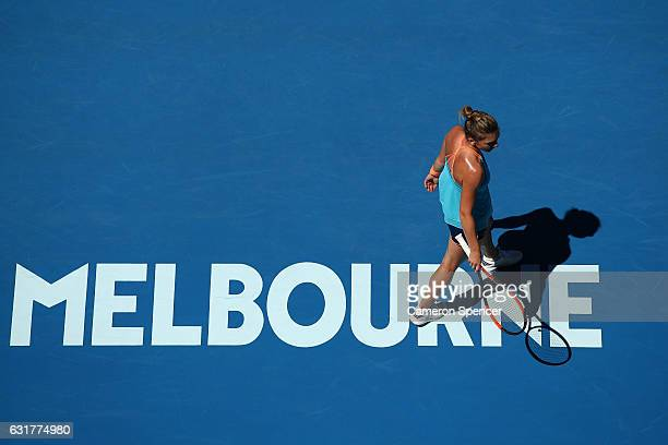 Simona Halep of Romania looks on in her first round match against Shelby Rogers of the Uniuted States on day one of the 2017 Australian Open at...
