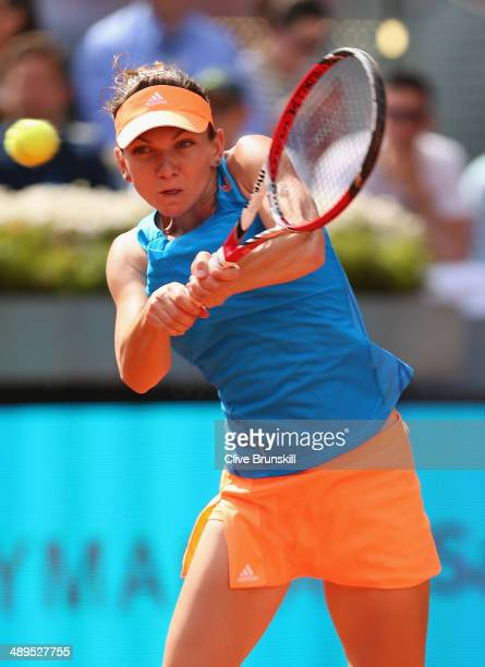 Simona Halep of Romania plays a backhand against Maria Sharapova of Russia in their final match during day nine of the Mutua Madrid Open tennis...