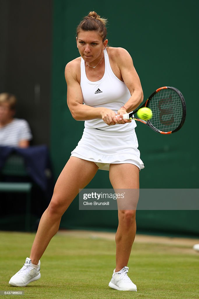 <a gi-track='captionPersonalityLinkClicked' href=/galleries/search?phrase=Simona+Halep&family=editorial&specificpeople=4835837 ng-click='$event.stopPropagation()'>Simona Halep</a> of Romania plays a backhand during the Ladies Singles second round match against Francesca Schiavone of Italy on day four of the Wimbledon Lawn Tennis Championships at the All England Lawn Tennis and Croquet Club on June 30, 2016 in London, England.