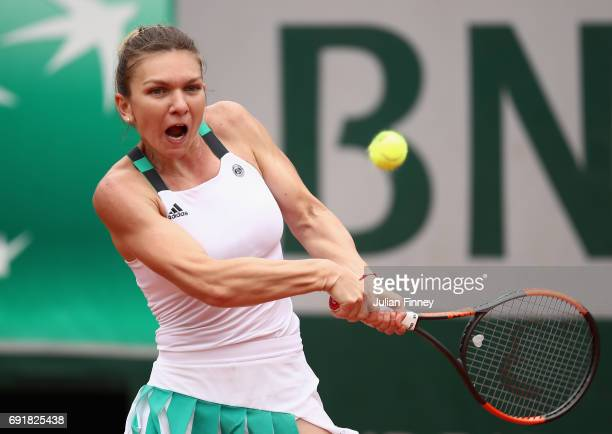 Simona Halep of Romania plays a backhand during the ladies singles third round match against Daria Kasatkina of Russia on day seven of the 2017...