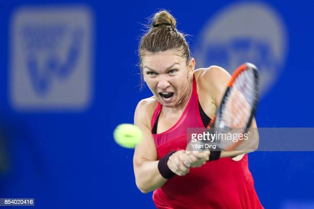 Simona Halep of Romania plays a backhand during the second round Ladies Singles match against Daria Kasatkina of Russia on Day 3 of 2017 Dongfeng...