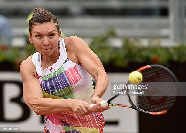 Simona Halep of Romania plays a backhand in her match against Daria Gavrilova of Australia on Day Four of The Internazionali BNL d'Italia on May 11...