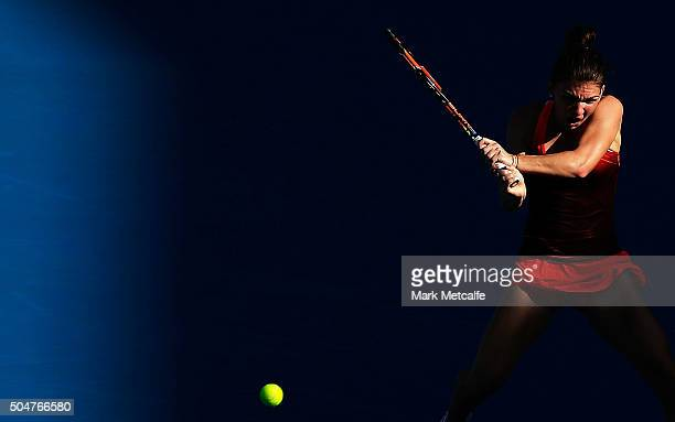 Simona Halep of Romania plays a backhand in her match against Karolina Pliskova of the Czech Republic during day four of the Sydney International at...