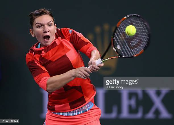 Simona Halep of Romania plays a backhand in her match against Vania King of USA during day five of the BNP Paribas Open at Indian Wells Tennis Garden...