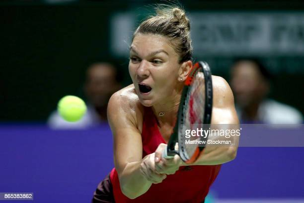 Simona Halep of Romania plays a backhand in her singles match against Caroline Garcia of France during day 2 of the BNP Paribas WTA Finals Singapore...
