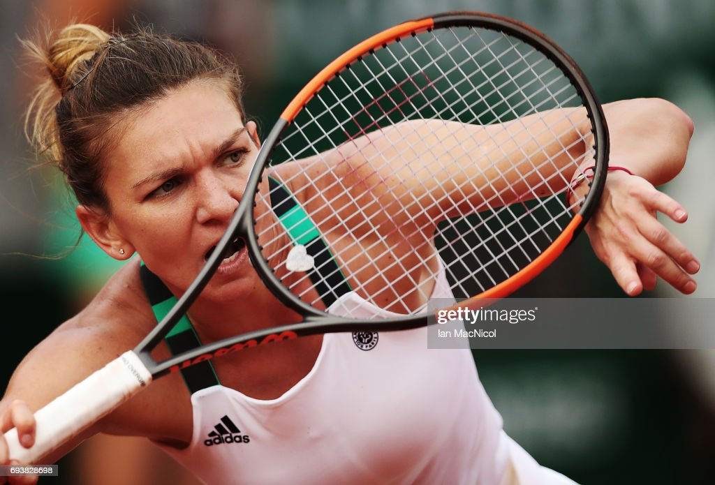 Simona Halep of Romania plays a backhand shot during her match with Karolina Pliskova of Czech Republic, during day twelve at Roland Garros on June 8, 2017 in Paris, France.