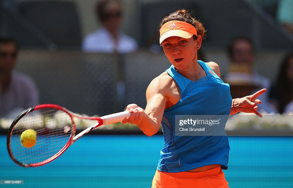 Simona Halep of Romania plays a forehand against Petra Kvitova of the Czech Republic in their semi final match during day eight of the Mutua Madrid Open tennis tournament at the Caja Magica on May 10, 2014 in Madrid, Spain.