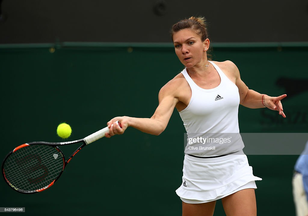 <a gi-track='captionPersonalityLinkClicked' href=/galleries/search?phrase=Simona+Halep&family=editorial&specificpeople=4835837 ng-click='$event.stopPropagation()'>Simona Halep</a> of Romania plays a forehand during the Ladies Singles second round match against Francesca Schiavone of Italy on day four of the Wimbledon Lawn Tennis Championships at the All England Lawn Tennis and Croquet Club on June 30, 2016 in London, England.